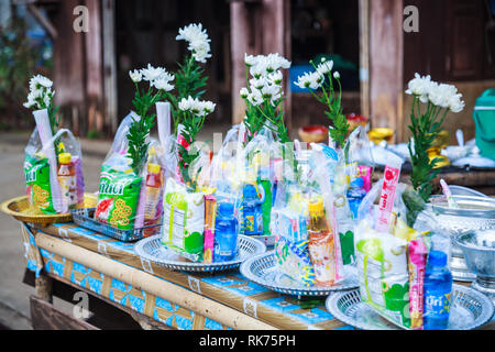 Kanchanaburi, Thailand - December 30, 2018: Alms prepared for Almsgiving (food offerings) to Buddhist monks going on daily alms round in the morning a - Stock Photo