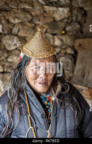 Old Layap woman in her house in Laya, Gasa District, Snowman Trek, Bhutan - Stock Photo