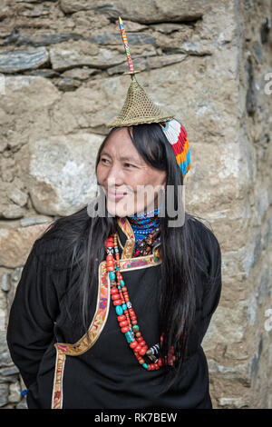 Smile of a Layap woman in traditional dress in Laya, Gasa District, Snowman Trek, Bhutan - Stock Photo