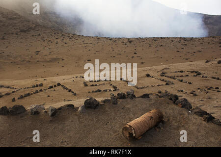 Mt Yasur, Tanna Island, Vanuatu is spelt out in stones on the walk to the smoking summit of the active volcano - Stock Photo