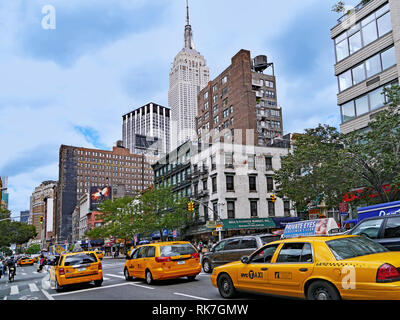 NEW YORK CITY - JUNE 2012:  Manhattan's busy avenues are usually full of yellow taxi cabs, as in this scene on 7th Avenue. - Stock Photo