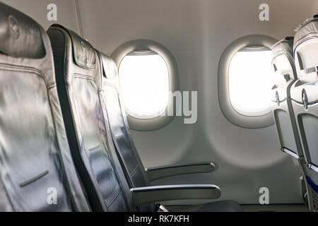 FRANKFURT, GERMANY - APRIL 07, 2016: inside of Lufthansa A320 economy class.  Deutsche Lufthansa AG, commonly known as Lufthansa is a major German air - Stock Photo