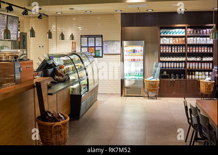 SAINT PETERSBURG, RUSSIA - AUGUST 04, 2015: Starbucks cafe interior. Starbucks Corporation is an American global coffee company and coffeehouse chain  - Stock Photo