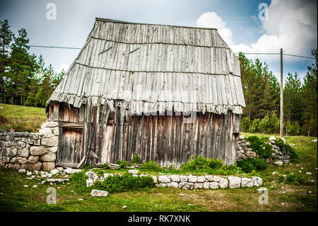 Abandoned rural wooden hut in the Durmitor National Park. Montenegro - Stock Photo