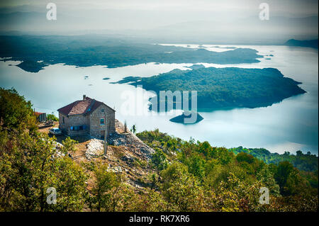 Country cottage on the lake in the Montenegro mountains. Beautiful view - Stock Photo
