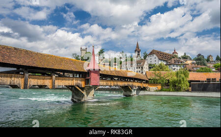 view of the Spreuer Bridge, a medieval covered wooden footbridge over the River Reuss at Lucerne, Switzerland - Stock Photo