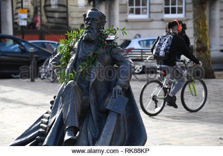 Charles Dickens statue in Guildhall Square in Portsmouth, Hampshire, he was born in the city on 7th February 1812. A wreath was put round his neck - Stock Photo