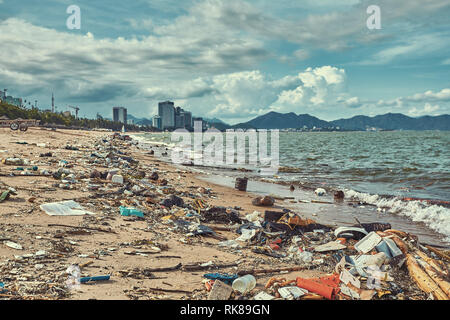 Heavily polluted with plastic garbage tropical beach - Stock Photo