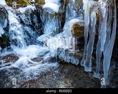 Amazing icicles on a small waterfall - Stock Photo