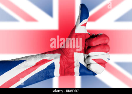 Brexit result - Thumbs up in front of Union Jack flag - Stock Photo