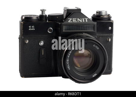 Riga, Latvia, march 2017: Zenit 11 is a Russian SLR camera with lens Helios 44-2m 58mm f2 for use with 35 mm film. Isolated on white background. - Stock Photo