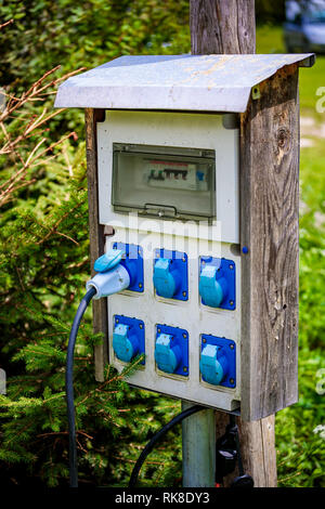 Power sockets at a camping site. Family vacation travel, holiday trip in motorhome, Caravan car Vacation VR. - Stock Photo