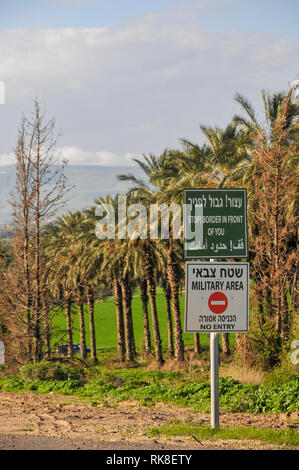 Stop, Border In Front of You. A warning sign in Hebrew Arabic and English. Photographed in The Golan Heights, Israel - Stock Photo