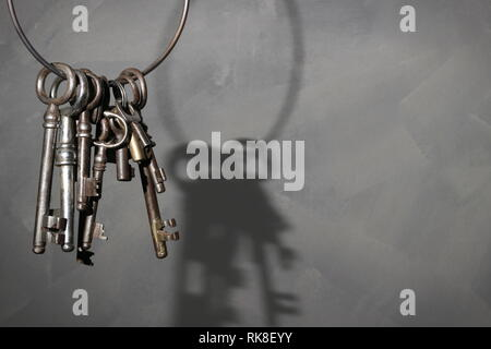Old antique vintage key on rustic background - Stock Photo