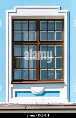 Rectangular window on the background of the wall in blue. From a series of windows of St. Petersburg. - Stock Photo