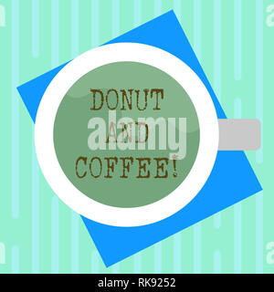 Word writing text Donut And Coffee. Business concept for common food and drink pairing in United States and Canada Top View of Drinking Cup Filled wit - Stock Photo