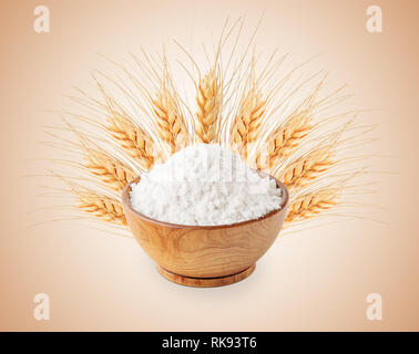 Bowl of white wheat flour and ears isolated - Stock Photo