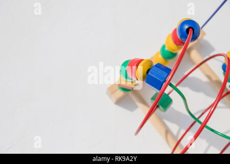 Bead roller coaster toy for child development, Logical thinking or problem solving.colorful bead maze toy. Fun and educational game. Concept of - Stock Photo