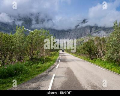 Steep granite cliffs at the road to Nusfjord, narrow single track road, Nusfjord, Flakstadøy, Lofoten, Norway - Stock Photo