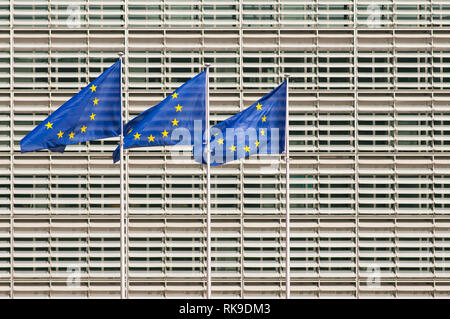 European Union flags in front of European Commission headquarters building, Berlaymont building. Brussels, Belgium - Stock Photo