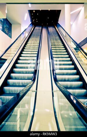 empty escalators in a shopping mall - Stock Photo