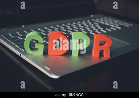 Close up of abbreviation GDPR set on the bottom of laptop standing on white table. Concept of personal data control and protection. Controllers of dat - Stock Photo