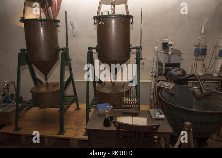 Sweet herbal liqueur 'Klosterbruder' is produced in the old brewhouse of Zinna Abbey a former Cistercian monastery in Jüterbog in Brandenburg, Germany - Stock Photo