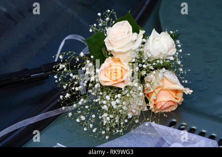 Roses, bunch of flowers tied to a car rear view mirror, Germany, Europe
