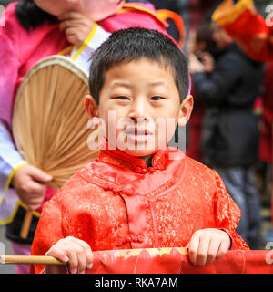 London, UK. 10th Feb 2019. A young performer. The performers make their way through Soho. London's Chinese New Year celebrations, the largest outside Asia, take place with colourful parades, lion and dragon dances, a procession through Soho, cultural performances and displays in and around Chinatown, the West End and Trafalgar Square. 2019 welcomes the Year of the Pig. Credit: Imageplotter News and Sports/Alamy Live News - Stock Photo