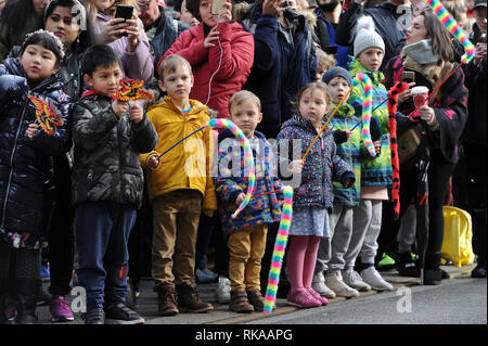 Manchester, UK. 10th Feb 2019. The annual Dragon Parade through the streets of Manchester, UK, to celebrate the Chinese New Year of the Pig. Youngsters watching the parade. Picture by Paul Heyes, Sunday February 10, 2019. Credit: Paul Heyes/Alamy Live News - Stock Photo