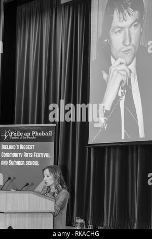 """St Marys College, Falls Road, Belfast, Northern Ireland, UK. 10th February 2019. Katherine Finucane (Daughter of murdered Human Rights lawyer Pat Finucan) Addressing a large crowd at """"A Community Reflects' on the murder of Pat Finucane. The Family are still waiting for a Full Public enquiry in to the Solicitors Murder. Credit: Bonzo/Alamy Live News - Stock Photo"""