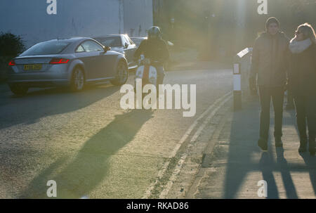 Sandsend, Whitby, North Yorkshire, UK. 10th February 2019. People enjoying the last of the late evening sun on a bright but cold day on the North Yorkshire coast.  Credit: Alan Keith Beastall/Alamy Live News - Stock Photo