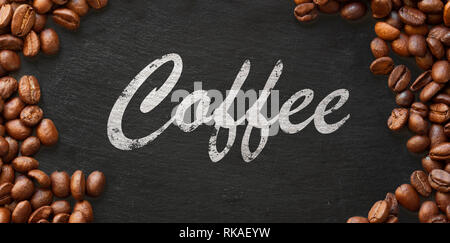 coffee handwritten on dark background framed with coffee beans - Stock Photo