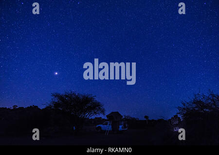 4x4 car with roof tent under a stairy night in Sesriem campsite, Namibia. Africa. - Stock Photo