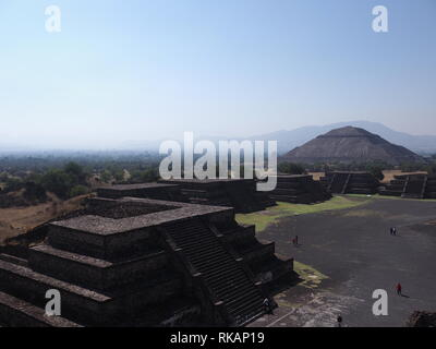 Scenic Avenue of the Dead and pyramid of the Sun on left at Teotihuacan ruins near Mexico city landscape - Stock Photo