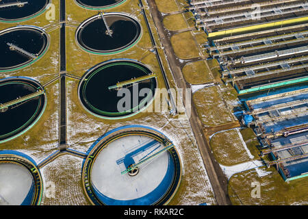 Sewage farm. Static aerial photo looking down onto the clarifying tanks. Industrial place. Geometric background texture. Photo captured with drone. - Stock Photo