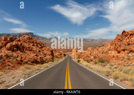 View down the centre of the road west from the Elephant Rock area of the Valley of Fire State Park, Nevada, United States. - Stock Photo