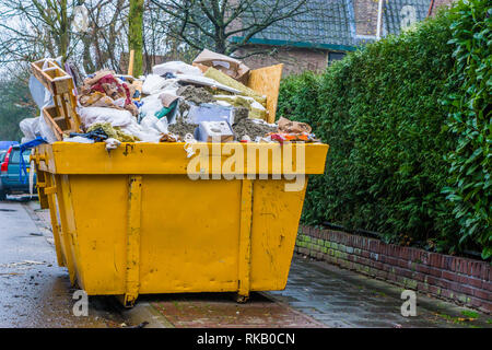 massive container full of bulky waste, pile of garbage, recycling concept - Stock Photo