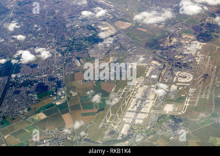 Aerial view of Charles de Gaulle in Paris, France on a sunny, summer day.  The smaller Le Bourget airfield is towards the top of the picture. - Stock Photo