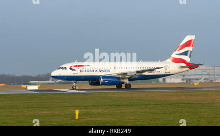 British Airways, Airbus A319-131, G-EUOA, ready for take off at Manchester Airport - Stock Photo