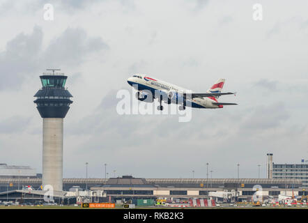 British Airways Airbus A319-131, G-EUPU,takes off at Manchester Airport - Stock Photo
