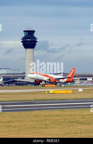 Easyjet Airbus A320-214, G-EZTZ at Manchester Airport during take off - Stock Photo