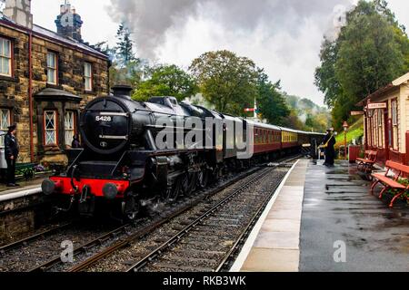 Thompson B1 leaving Gothland (Aidensfield) on the North Yorkshire Steam Railway - Stock Photo