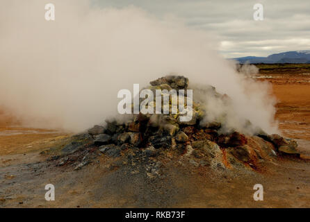 A fumarole at Namafjall in Iceland. - Stock Photo