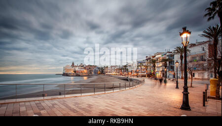 Colorfull sunset in Sitges, very touristic village near Barcelona. - Stock Photo