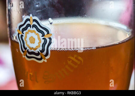 Close up view of a glass of Samuel Smith's Best Bitter in a pint glass showing the white rose of Yorkshire, Beverley, East Riding, Yorkshire, England - Stock Photo