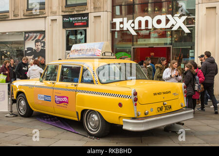 Checker Taxi was an American Taxi Company. This iconic vehicle is parked outside T.K. Maxx on Northumberland Street in Newcastle's City Centre, UK. - Stock Photo