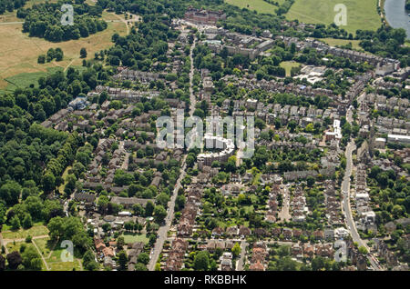 Aerial view looking along Queens Road in Richmond, South West London on a sunny summer afternoon. Richmond Park is to the left and at the top is the l - Stock Photo