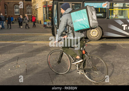 Man with a Deliveroo box on his back in Newcastle City Centre, England, UK. - Stock Photo