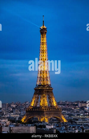 The Eiffel Tower illuminated at night as seen from the Top Of  The Arc de Triomphe de l'Étoile on a Summer night in Paris - Stock Photo
